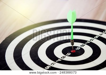 Classic Bull Eye Target Hitted By Arrow Into The Center Of Bull Eye Target Close Up.