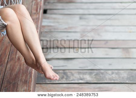 Woman Cross Leg With Happy And Relax Time Feeling On Holiday