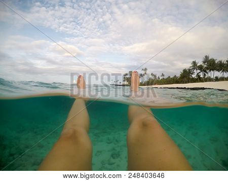 Legs And Feet Pov - Split Point Of View Of Female Floating In Clear Sea At A Beach At Matautu, Lefag