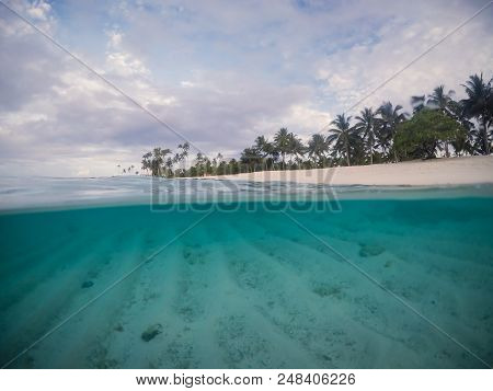 Half And Half Split Scross Section Of Clear Sea And Empty Beach With Palm Trees At Matautu, Lefaga,