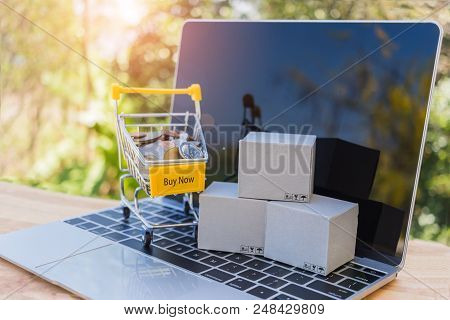 Money In Shopping Cart And Cardboard Box On Tablet. Consumers Can Buy Products Directly From Seller