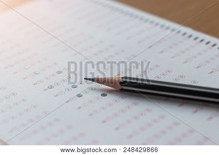 Black Pencil On Paper Computer Sheet. Standardized Test Form With Answers Bubble. Multiple Choice An