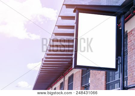 Blank White Billboard On City Street. In The Background Street And Building. Mock Up. Poster On Stre