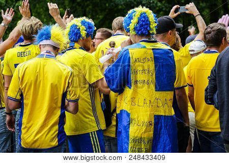 St. Petersburg, Russia - July 3, 2018: Backs Of Swedish Football Fans Supporting Sweden National Foo