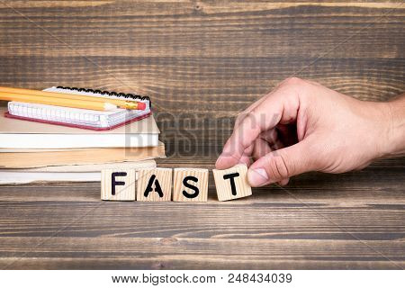 Fast. Abstract Business, Law And Cyber Security, Privacy Concept. Wooden Letters On The Office Desk,