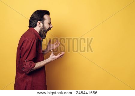 Portrait Of Screaming Frustrated Angry Man. Guy Hands Up And Screaming. Furious Guy With Hipster Hai