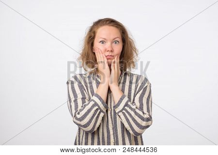 Young Sad Woman In Striped Shirt Serious And Concerned Looking Worried And Thoughtful. Facial Expres