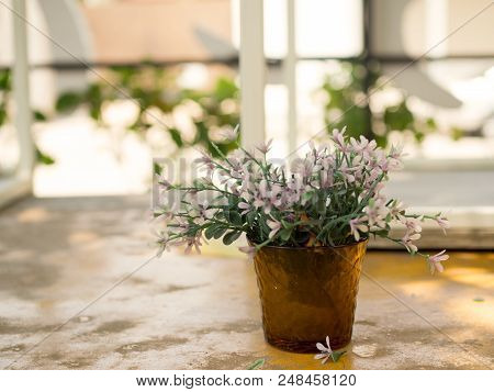 White And Purple Plastic Flowers In Vase Decorative Table Outside Home. Home Design.