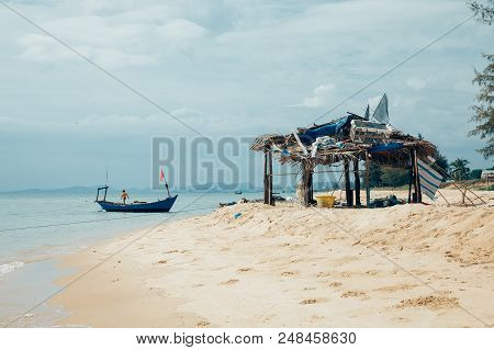 Phu Quoc, Vietnam - April 6: A Local Boy Working On A Fishing Boat At The Beach On April 6, 2014 In