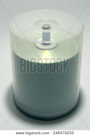 Stack Of Blank Discs In Storage Case On Spindle. Capacity Of Plastic Tube Is Up To Hundred Cds
