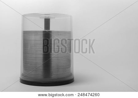 Transparent Rim Of Cds In Stack. Storage Box With Blurry Visible Spindel Under Screwed Cover. Black