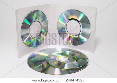 Case For Mini Cds. Inner Trays Of Double-sided Semitransparent Plastic Box With Iridescent Discs On
