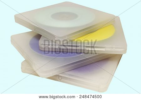 Translucent Cases With Disks. Stack Of Multicolored Midi-discs In A Regular Double Plastic Boxes Wit