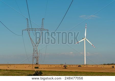 Large View On The Windmill And Powerline On The Field