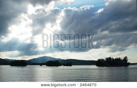 Heavenly Light Over A Tranquil Lake