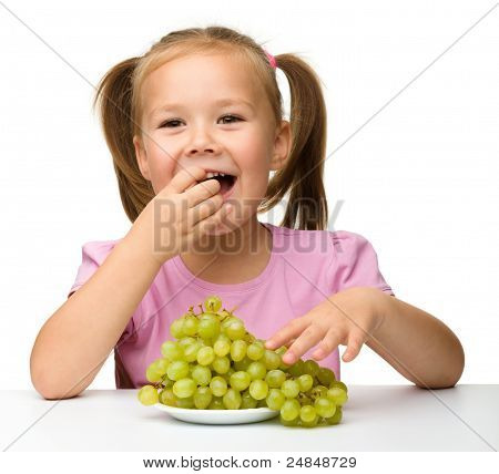 Little Girl Is Eating Grapes