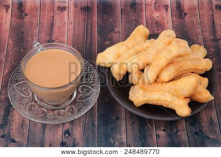 Ready Served Of A Cup Of Coffee And Patongko (deep-fried Dough Stick)