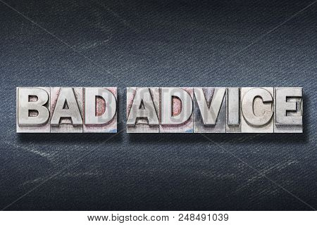 Bad Advice Phrase Made From Metallic Letterpress On Dark Jeans Background