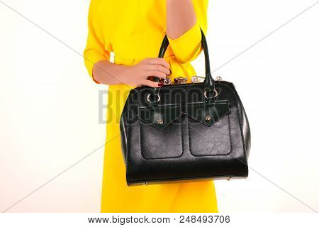Slim Girl In A Yellow Dress With Green Bag. Bright Summer Colors.