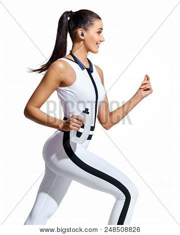 Young Fitness Woman Running With Bottle Of Water In Silhouette On White Background. Dynamic Movement