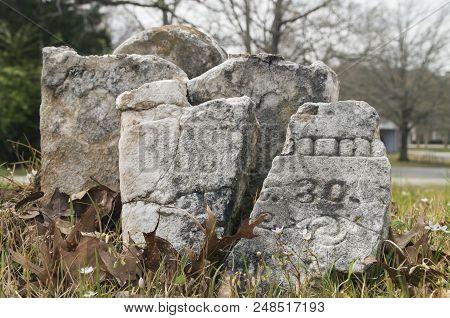 A Civil War Era Headstone rests in a church cemetery in Birmingtham,Alabama poster