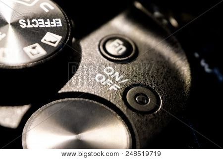 Close-up Macro Shot Of Black Camera Body With Buttons To Control And Switch Shooting Modes. Selectiv