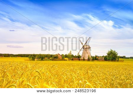 Wooden Windmill On Background Field And Sky. Dudutki Village, Minsk Region, Belarus
