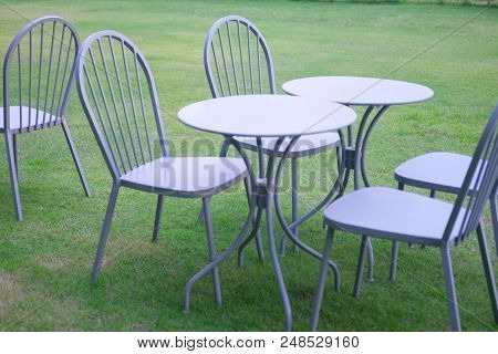 Set Of Metal Chairs And Tables For Garden Decor