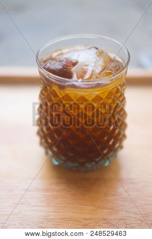 Longan Juice With Ice In Glass On Wood Tray
