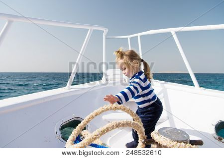 Yachting Sport. Child Cute Sailor Help With Ropes Yacht Bow. Adventure Boy Sailor Travelling Sea. Ba