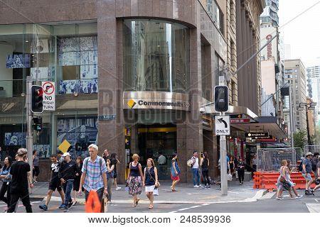Commonwealth Bank On Corner Of  Margaret Street, Cbd Area With Crowd Of People Walking Across Street