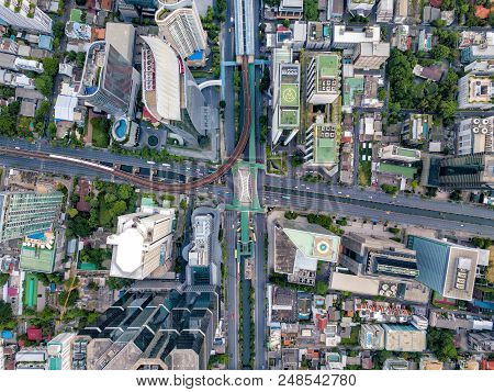 Top View Of City Road Junctions In Heart Of Business Center On Sathorn And Silom District At Bangkok