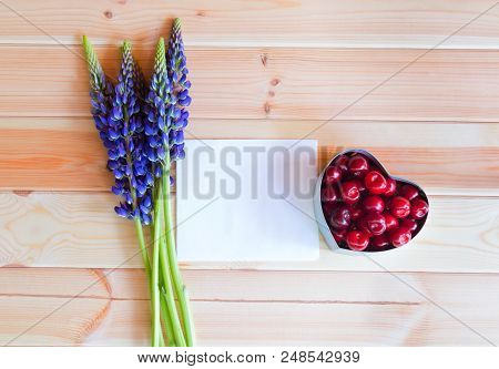 Blue Wildflowers Lupine, Heart Shape Gift Box With Fresh Cherry And Empty Card For Your Text On Wood