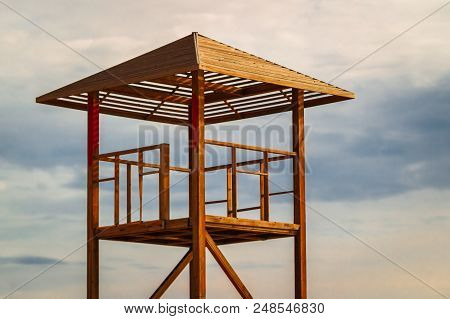 Empty Lifeguard Station At A Beach Against The Cloudy Sky Background