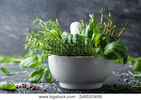 Fresh Herbs And Spices For Traditional Italian Cuisine. Rosemary, Basil, Thyme, Tarragon, Pepper And