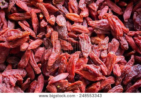 Close-up Of Red Dried Goji Berries. View From Above To Healthy Red Goji Berries. Natural Food And Ba