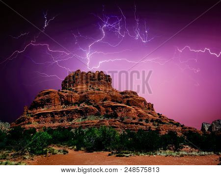A Spider Web Of Lightning Flashing Over Bell Rock Near Sedona Arizona During A Monsoon Storm. Spider