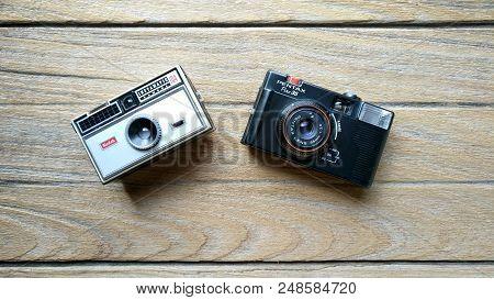 Bangkok, Thailand - March 20, 2017 : Kodak Instamatic 104 Camera And Pentax Pino 35 On A Wood Table.