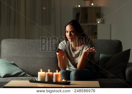 Angry Woman Trying To Watch Tv During A Blackout