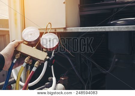 Technician Is Checking Air Conditioner Maintenance Concept
