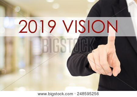 2019 Vision Banner, Businessman Hand Touching 2019 Vision Word Over Blur Background, Annual Business