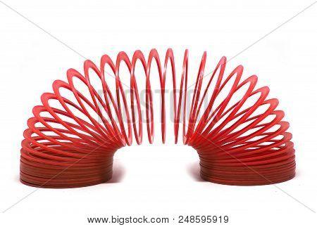 Bangkok, Thailand - March  20, 2018 : Red Slinky Spring Toy Isolated On White Background. Illustrati