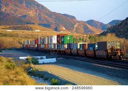 July 7, 2018 In Cajon, Ca:  Freight Train Transporting Commerce Towards Los Angeles Taken In Cajon,