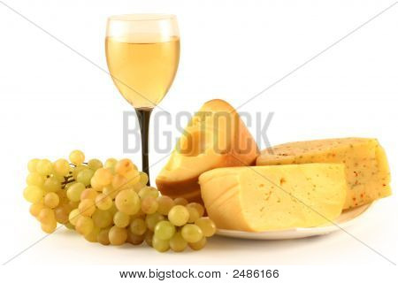 Grapes, Cheese And A Glass With Wine