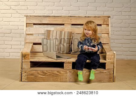 Modern Technologies. Child With Laptop And Mobile Phone, Education. Small Boy Blogging On Bench, Onl