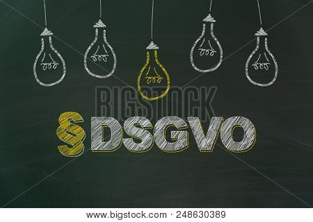Dsgvo In German Chalk Writing Meaning Gdpr With Yellow And White Light Bulbs Painted On Dirty Green