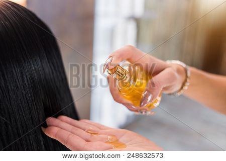 Oil Hair Treatment For Woman. Spa, Beauty Salon. Hair Care In Modern Spa Salon. Hairdresser Woman Ap