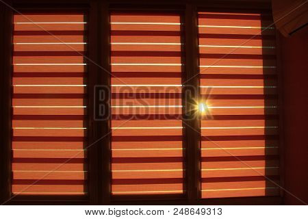 Modern Jalousie Day And Night Horizontal On Window. Room Design Element. Sunny Ray Making Its Way Th