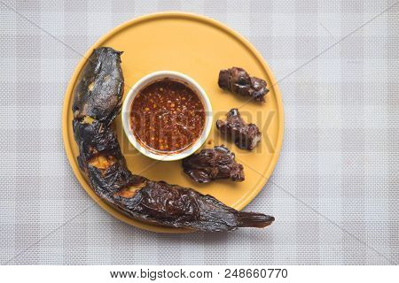 Grilled Catfish And Grilled Liver With Spicy Sauce In A Yellow Plate