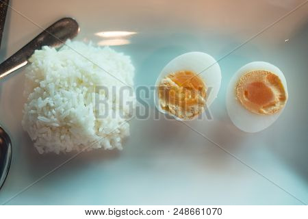 Close Up Cooked Jasmine Rice And Boiled Egg In Dish